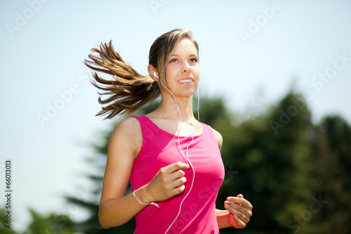 Running woman in park in summer training