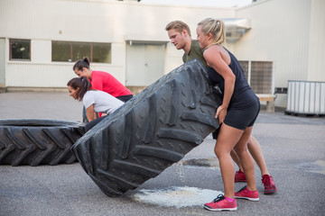 Flipping tractor tires as outdoor workout