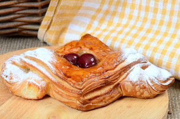 Roll from flaky pastry with cherry