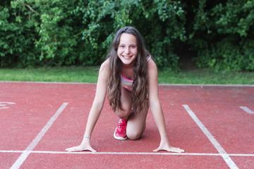 Mädchen macht sich bereit für sprint