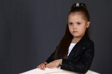 beautiful young female child model wearing a black