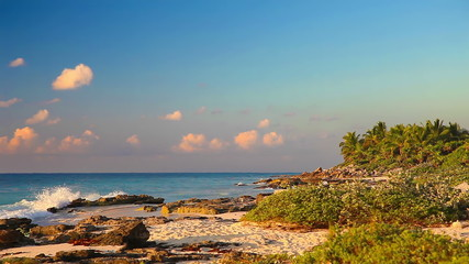 Early morning on a wild beach of the Caribbean sea