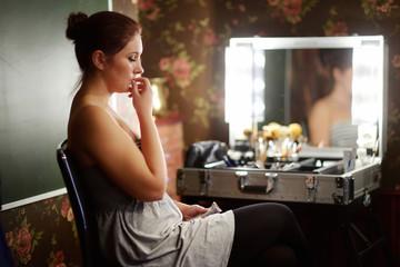 Young beautiful woman at a make-up studio