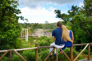 Young couple enjoying a view on Chamarel falls