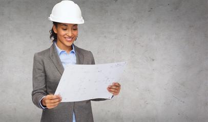 businesswoman in white helmet with blueprint