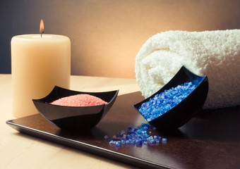 Spa massage border background with towel, candle and sea salt