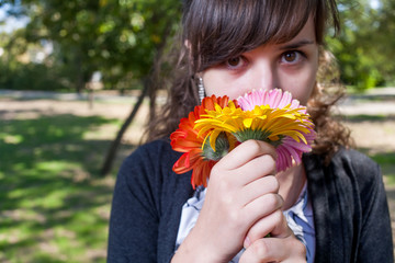Cute women smelling bunch of flowers