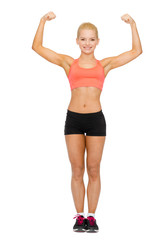 smiling sporty woman flexing her biceps