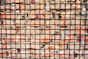 Brick wall with iron grid