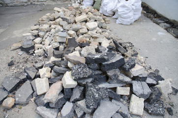 a pile of broken asphalt and bricks