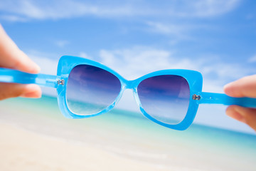 close up of fancy sunglasses. sunny beach in thailand