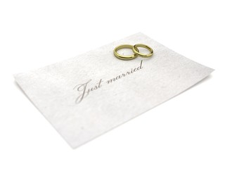 wedding rings on paper just married