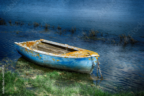 Old painted fishing boat - 66021424