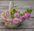 Bouquet of wild rose in vintage style on basket
