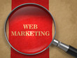 Web Marketing Concept Through Magnifying Glass.
