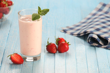 strawberry with yogurt in a glass on a wooden background