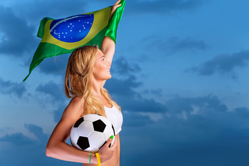 Happy fan of Brazilian football team