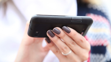 Hands of woman using cell phone smartphone