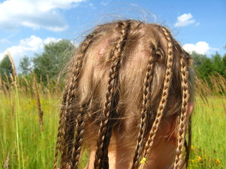 little girl with a lot of braides