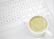 Coffee cup on the keyboard