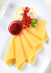 Cheese and red currant sauce