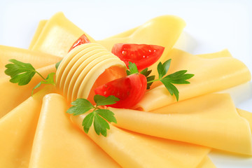 Sliced cheese, butter and tomato wedges