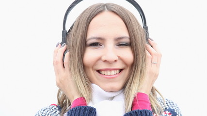 Girl with headphones listening to music and winking blinking