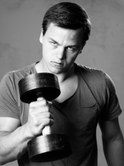 Young man training with dumbell