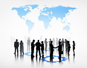 Group Of Business People Standing Beneath The World