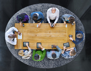 Group of Diverse People in a Table Using Devices
