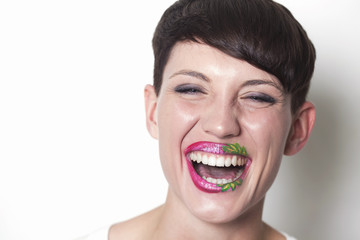 Woman with strawberry lips laughing