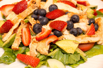 Chicken salad  with lettuce, blueberry and strawberry