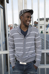 Handsome African American male model laughing outdoor portrait