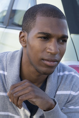 African American male model wearing gray sweater