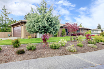 Curb appeal. House with landscaped front yard