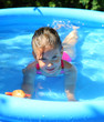 girl bathes in inflatable pool