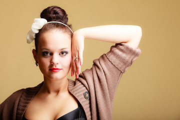 Portrait young beautiful  girl retro style make-up and hair bun