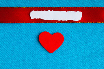 Valentines day background. blank heart on blue fabric material