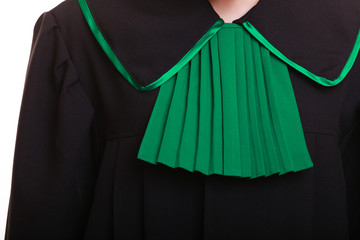 Law justice. Closeup lawyer polish black green gown