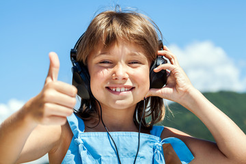 Happy little girl in headphones