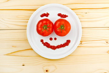 Fun food for children - tomatoes making smiley face