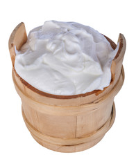 fresh yogurt in a wooden bowl isolated on white