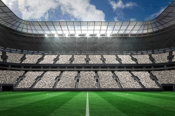 Large football stadium with white fans