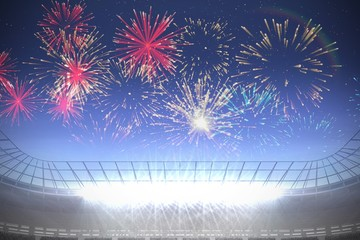 Fireworks exploding over football stadium