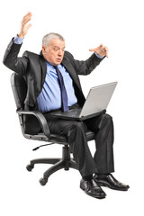Shocked businessman having problems with a laptop