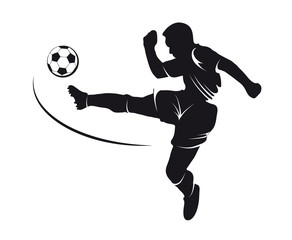 silhouette of a footballer beating on a ball