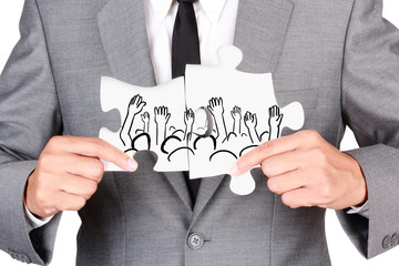 Businessman showing jigsaw connect create people hand up