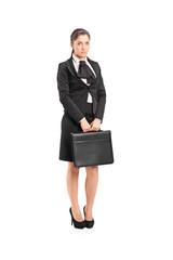 Sad businesswoman holding a briefcase