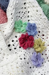 Colored Crochet Flowers on White afghan