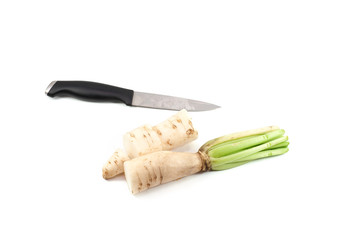 Daikon radishes with knife